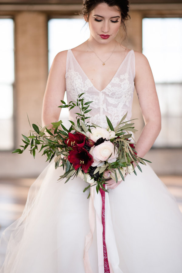A  bride with her bouquet before her Journeyman Distillery wedding