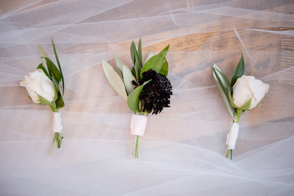 White and burgundy boutonnières
