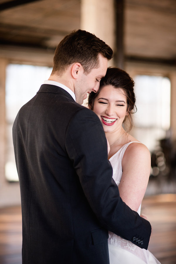 A bride and groom smiling during their wedding