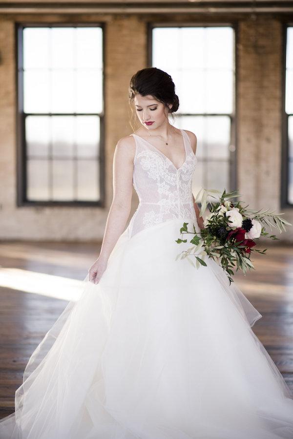 A bride before her Journeyman Distillery wedding