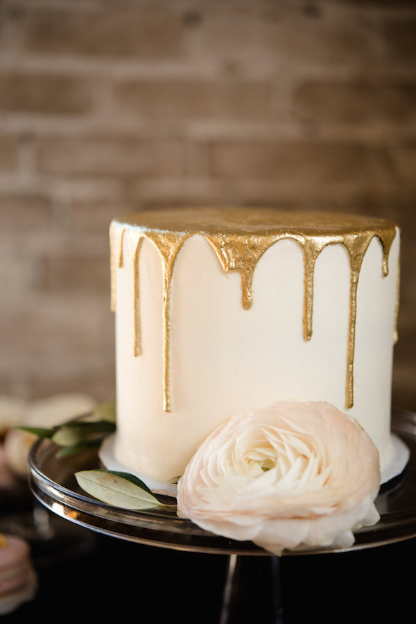 A gold drip wedding cake