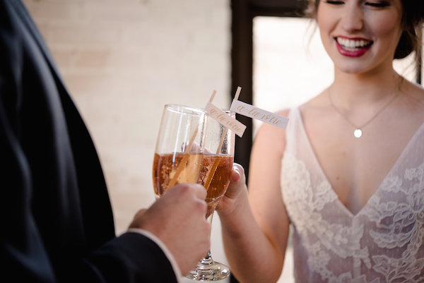 A couple sharing a glass of champagne during a Journeyman Distillery wedding
