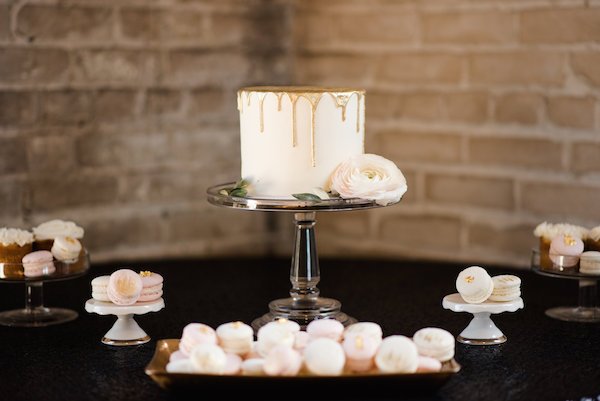 A gold wedding cake with french macarons