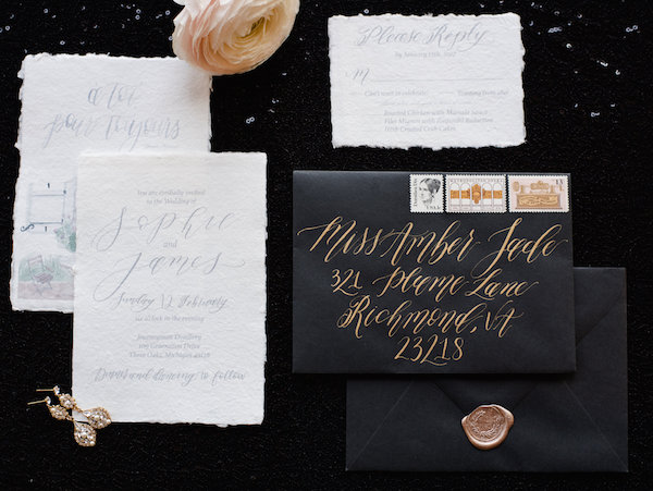 Black and white invitation suite with gold ink