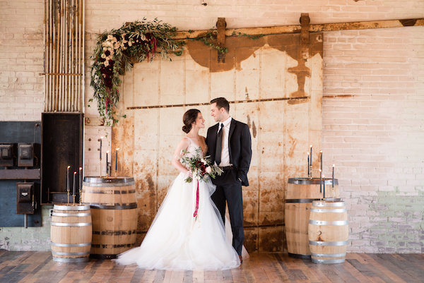 Couple smiling during a Journeyman Distillery wedding