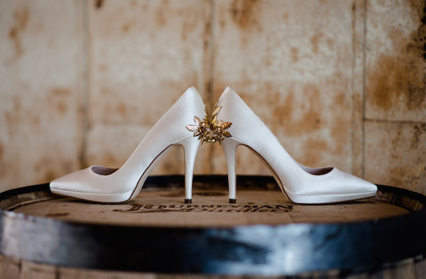 White bridal shoes with gold details