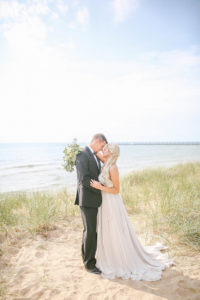 Bride and groom on Lake Michigan beach