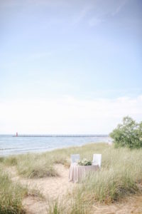 Sweetheart table on sandy beaches of Lake Michigan