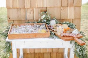 Appetizer table on wood shaker shingle backdrop