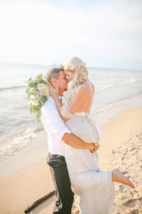 Newlyweds on the beach of South Have, Michigan