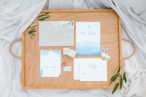 Coastal inspired invitation suite with vintage stamps