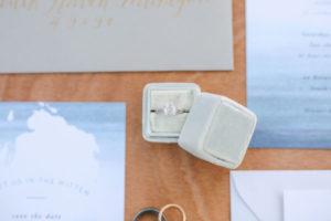 Light blue velvet ring box with wedding ring