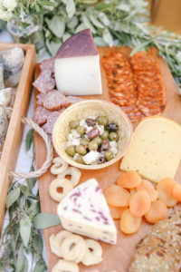 Fresh charcuterie board on wooden cheese board