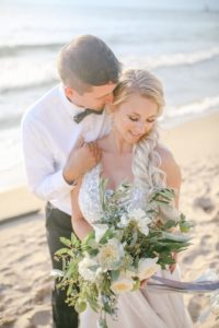 Bride and groom smiling on the beach of Lake Michigan