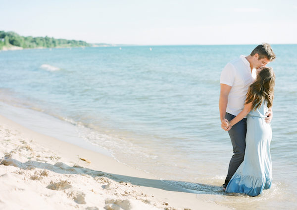 A couple kissing on the beach during their Lake Michigan engagement session