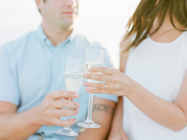A couple enjoying champagne the week before the wedding