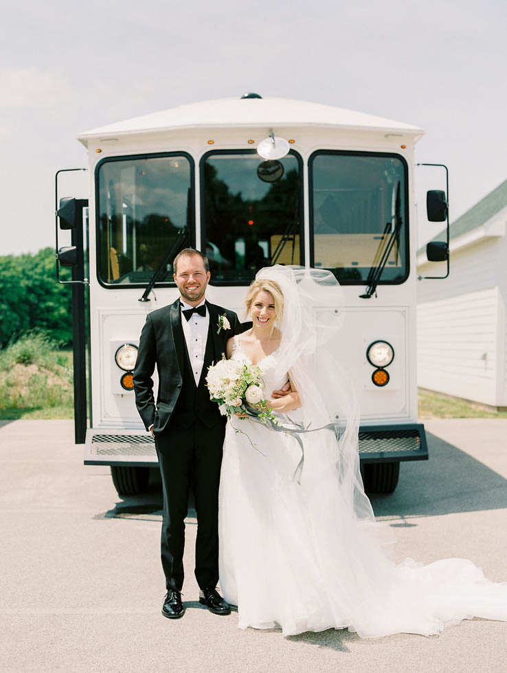 Bride and groom Traverse City wedding transportation
