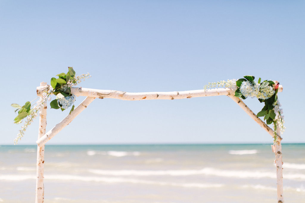Arbor set-up for a wedding ceremony on the beach in Benton Harbor, MI