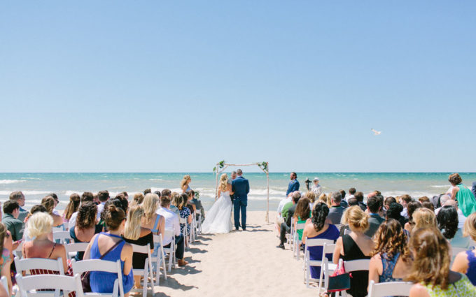 Couple getting married on the beach of Jean Klock Park in Benton Harbor, MI