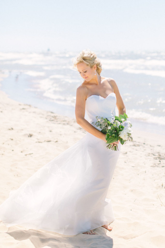 Bride stands next to Lake Michigan