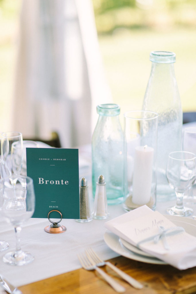 Blue sea glass table decor at a 12 Corners Vineyard Wedding