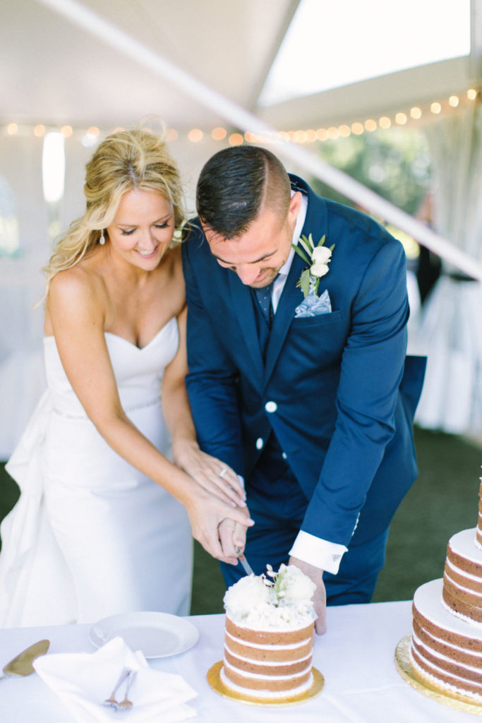 Couple cutting their cookie cake at their 12 Corners Vineyard Wedding