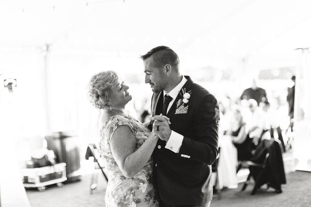 Groom shares a dance with her mother at his 12 Corners Vineyard Wedding