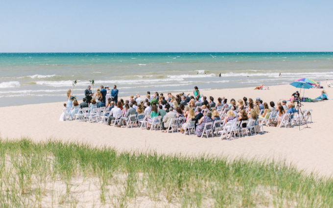 ceremony happening during beach wedding in michigan
