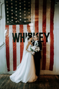 Couple smiling at a Journeyman Distillery wedding