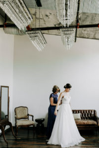 Bride gets dressed at her Journeyman Distillery wedding