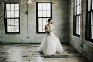Bride with her bouquet at a Journeyman Distillery wedding
