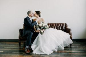 Bride and Groom kissing in the bridal suite at a Journeyman Distillery wedding