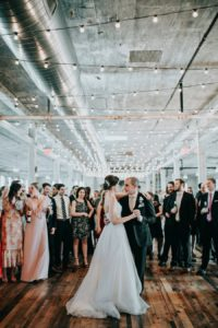 Bride and groom share a first dance at a Journeyman Distillery wedding