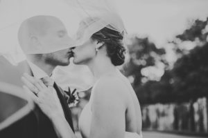 Bride and groom kissing outside at their Three Oaks, Michigan wedding