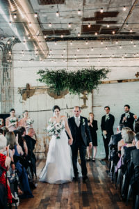 Couple walking down the aisle at a Journeyman Distillery wedding