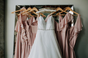 Bridal gown and blush bridesmaids dresses