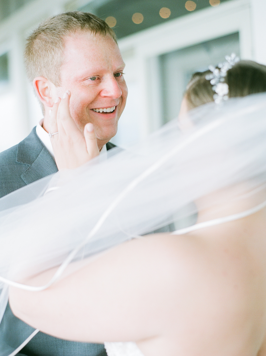 Bride and groom share a first look before their camp blodgett wedding