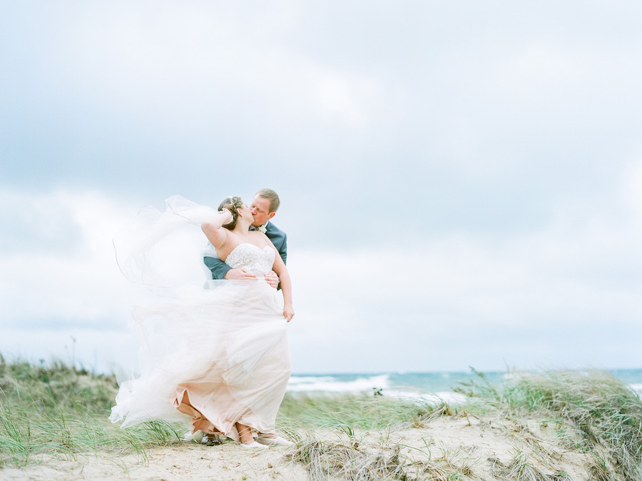 Bride and groom on the beach at their Lake Michigan wedding