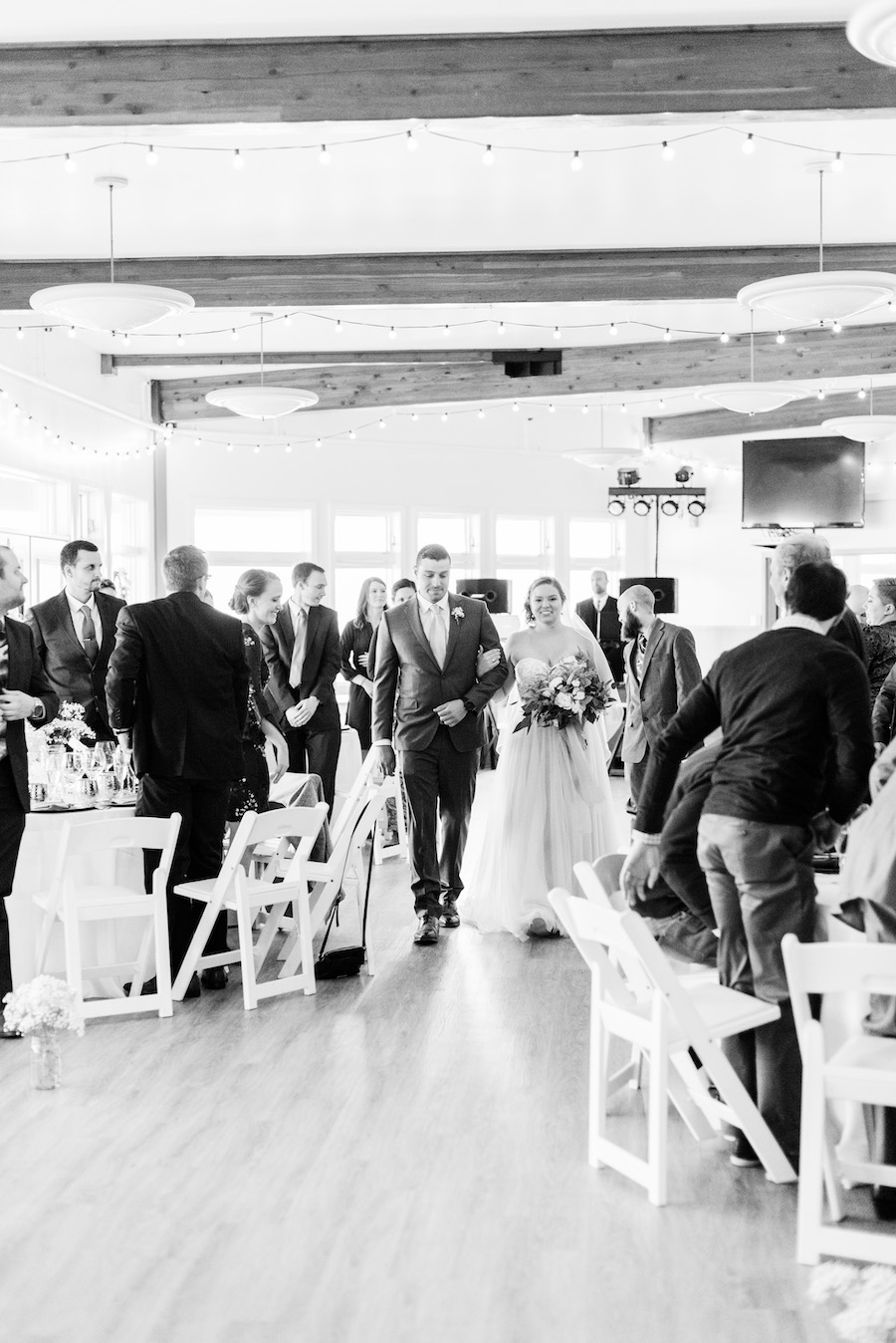 Bride walking down the aisle at her camp blodgett wedding