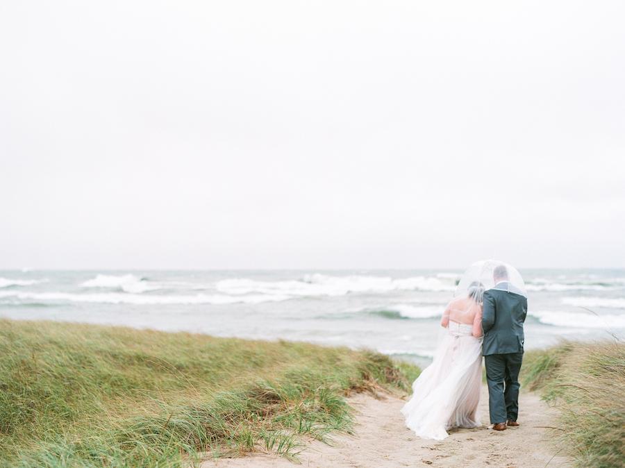 Newlyweds enjoying the views of Lake Michigan