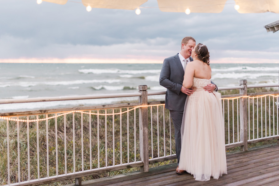 Newlyweds enjoy the sunset during their camp blodgett wedding