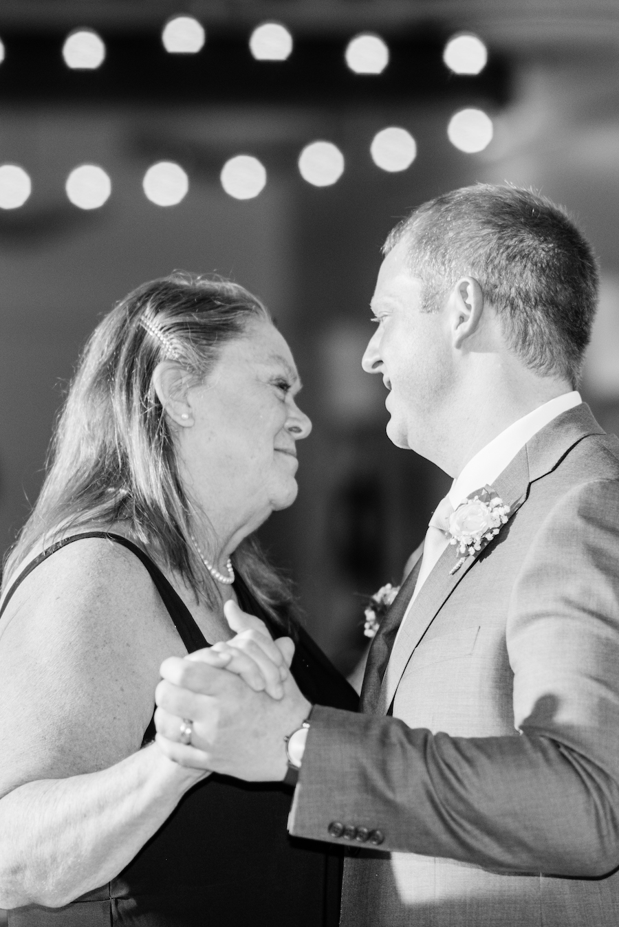 Groom and mother sharing a dance at his West Olive, Michigan wedding