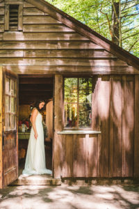Bride gets dressed in the craft cabin at Long Lake Outdoor Center Wedding