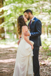 Bride and groom sharing a kiss before their Long Lake Outdoor Center Wedding