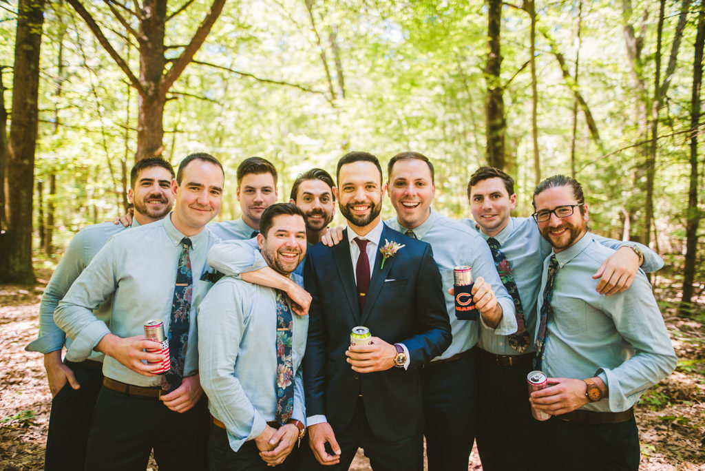Groom and groomsmen smiling before Long Lake Outdoor Center Wedding