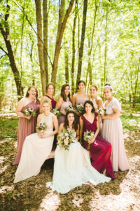 Bride and bridesmaids smiling before a Long Lake Outdoor Center Wedding