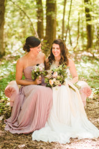 Bride and bridesmaid laughing at a Long Lake Outdoor Center Wedding