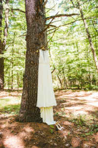 Dress hanging from a tree at a Long Lake Outdoor Center Wedding