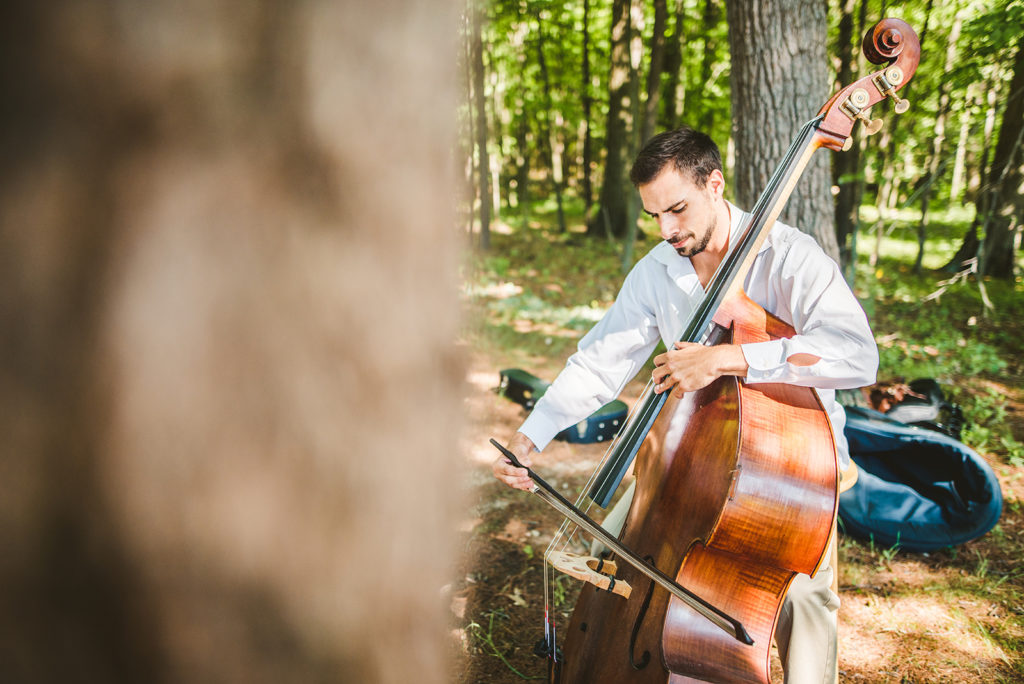 Musician playing before a Long Lake Outdoor Center wedding