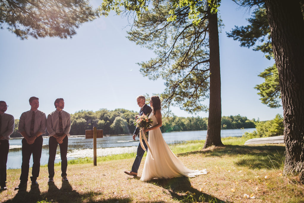 Bride and her father walking down the aisle at a Long Lake Outdoor Center wedding